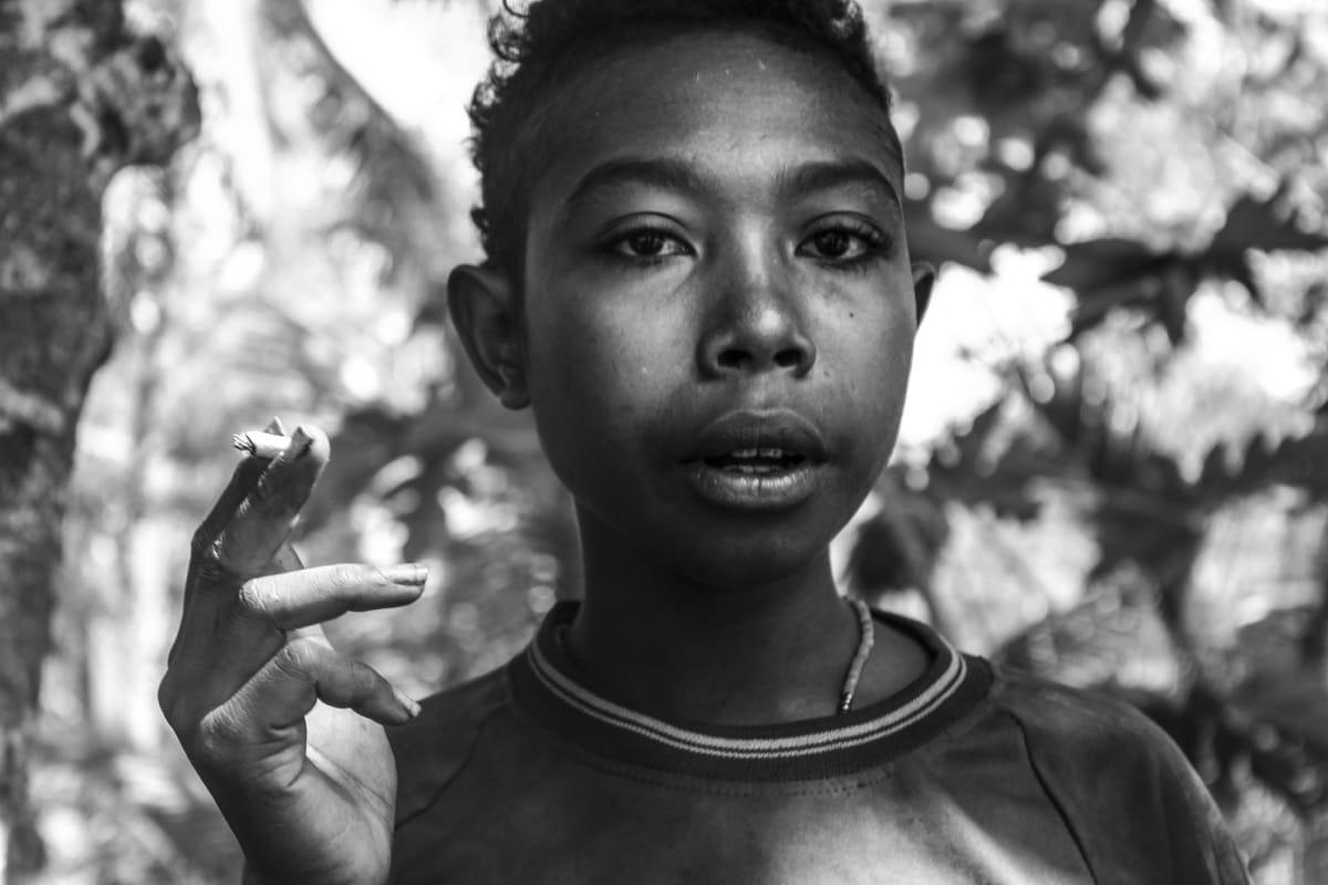 Papua New Guinea kid smoking