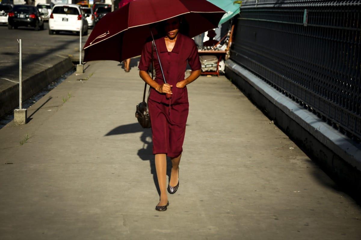 Guyana woman umbrella