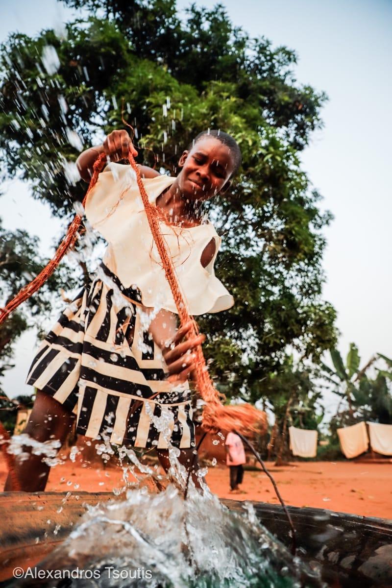 Cameroon girl water bucket