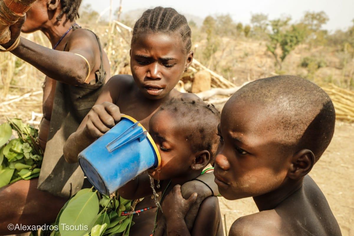Mali thirsty kid water