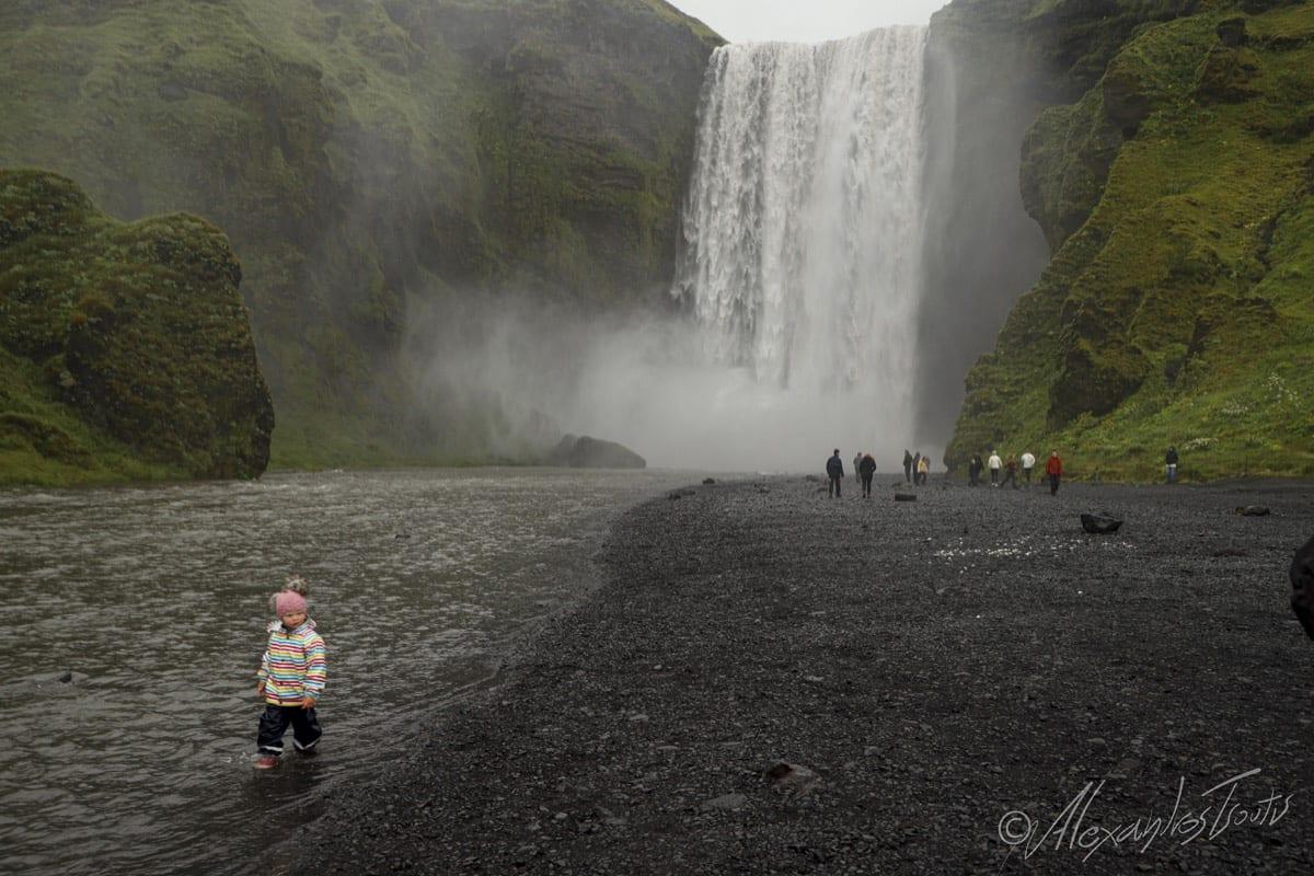 Iceland child waterfall