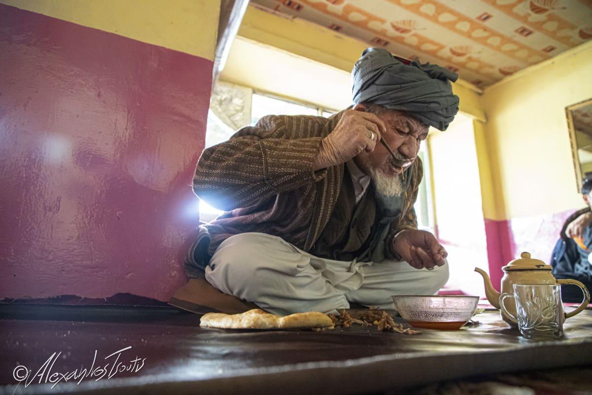 Afghanistan old man eating