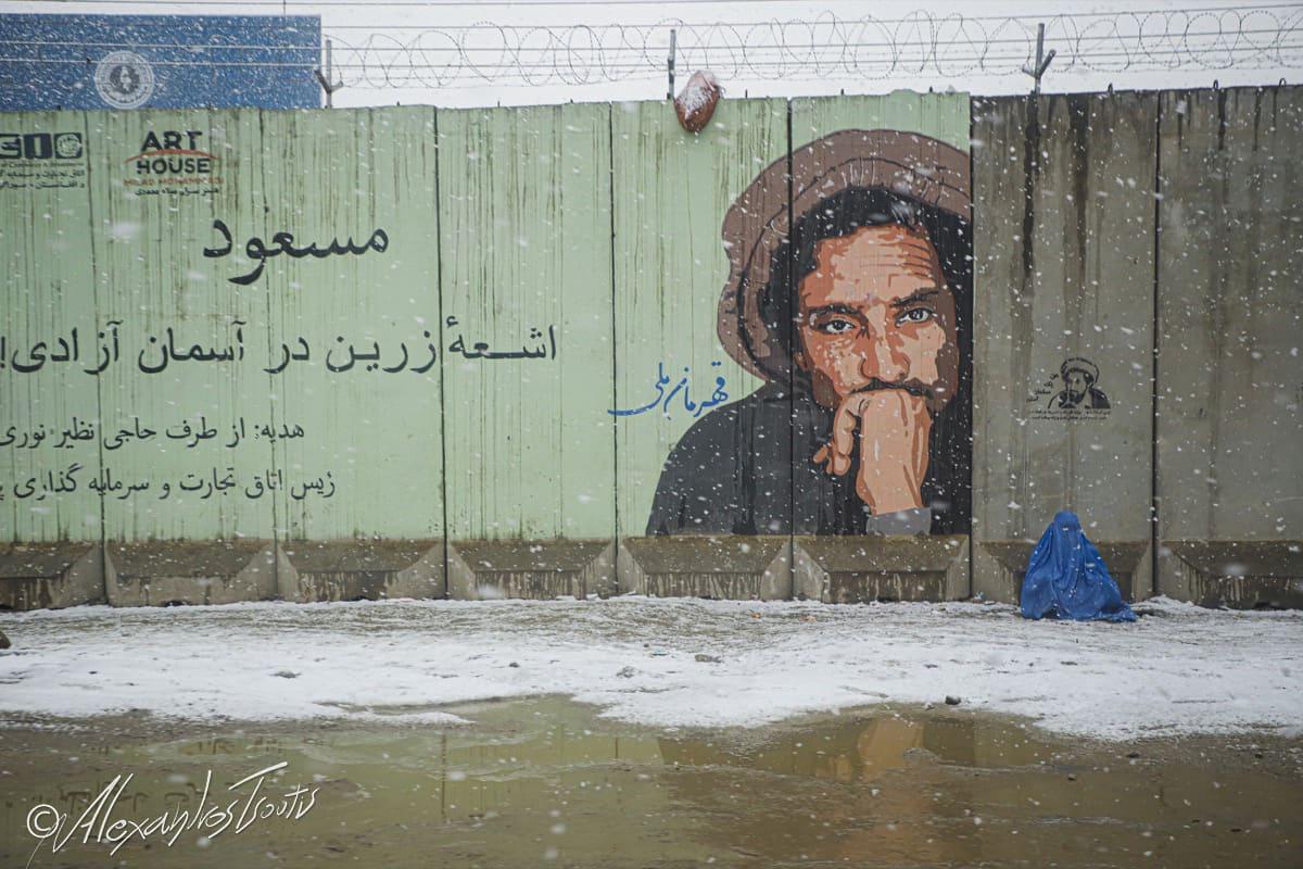 Afghanistan snow homeless woman Massoud